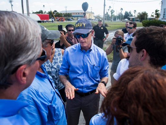 Governor Rick Scott talks with Howie Grimm, second
