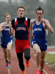 Cedar Crest's Jesse Cruise fights off Lebanon's Derin Klick during the last 100 meters of a 1,600-meter race last spring. Cruise will again help lead the Falcons in 2016.