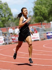 Navajo Prep's Sarah Chacon runs in a preliminary heat of the 400 meters on May 8, 2015, at the 3A state track and field meet in Albuquerque.