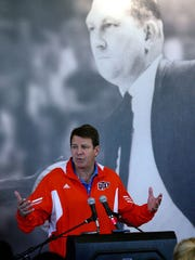 Tim Floyd speaks in front of an image of his mentor, legendary UTEP basketball coach Don Haskins.