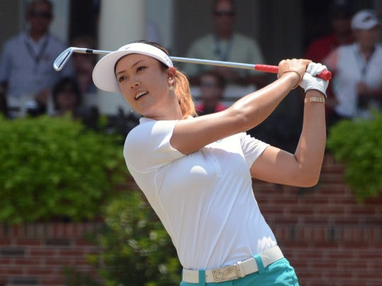 Michelle Wie takes a practice swing on the first tee during the first round of the U.S. Women's Open at the Pinehurst Resort and Country Club-#2 Course.