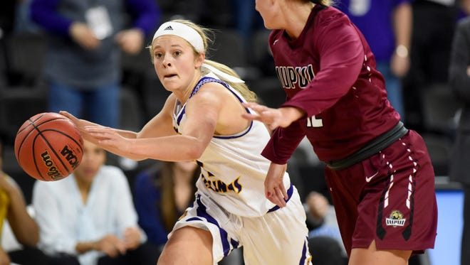 Western Illinois University's Emily Clemens drives the ball up the court while IUPUI's Caitlyn Tolen chases after during the Summit League women's basketball championship on Tuesday, March 7, 2017 at the Denny Sanford Premier Center.  Final score was 77-69.