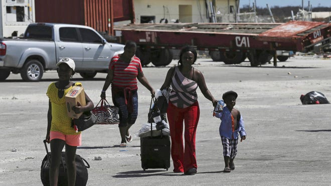 Evacuees carry their belongings as they boarded a ferry to depart for Nassau in the aftermath of Hurricane Dorian, at the port of Marsh Harbor, Abaco Island, Bahamas on Sunday. It's been nearly a week after disaster roared in from the sea as the most powerful hurricane in the northwestern Bahamas' recorded history.