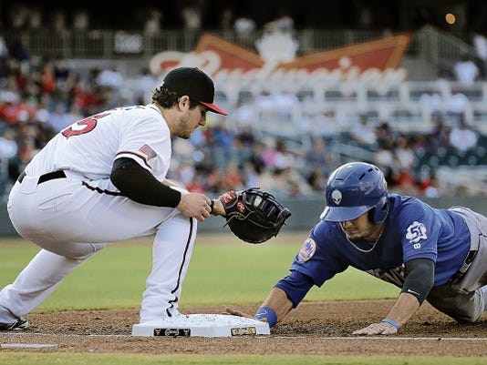 RUBEN R. RAMIREZ—EL PASO TIMES Chihuahuas first baseman Jason Hagerty just misses the pick poff at first base against Las Vegas 51's centerfielder Darrell Ceciliani, in the teams final game of the current homestand at Southwest University Park.