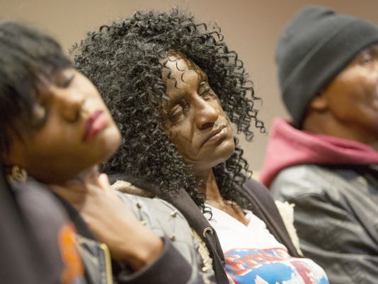 Family members of Freddie Gray, sister Fredricka Gray, left, mother Gloria Darden, center, and stepfather Richard Shipley listen during a news conference April 27 after a day of unrest following the funeral of Freddie Gray in Baltimore.