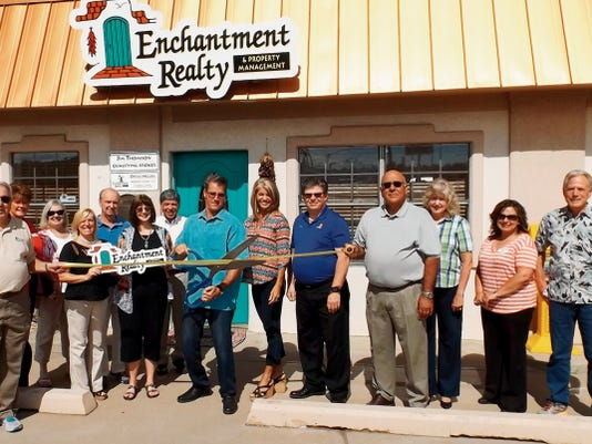 A ribbon cutting ceremony was held Thursday for Enchanted Realty & Property Management, which used to be Coldwell Banker´s Real Estate.ÊThe real estate office is located at 501 Silver Heights Blvd. in Silver City.Ê Cutting the ribbon is Jim Thomison, qualified broker, his wife Kim Thomison, along with the real estate agency staff and local members of the Silver City Grant County Chamber of Commerce. Courtesy Photo