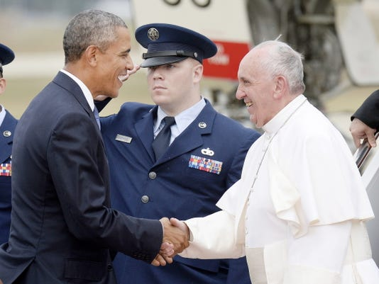 U.S. President Barack Obama greets His Holiness Pope Francis on his arrival Tuesday at Joint Base Andrews in Maryland.