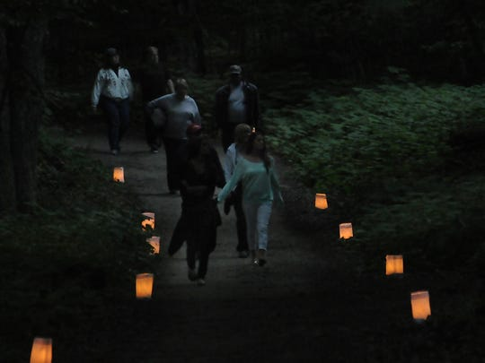 More than 1,000 walkers participated in a candlelight