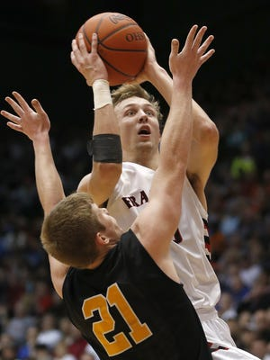 Franklin's Luke Kennard drives to the basket during Friday's 62-55 win over Springfield Shawnee.