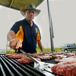Mike Miragliotta, of the Pensacola Subwest Rotary Club, cooks up some burgers Saturday during the Burger Battle By the Bay at Vince J. Whibbs Sr. Community Maritime Park.