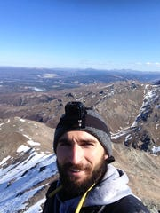 Michael Purdy, 24, of Lansing, died on April 26 in Denali National Park in Alaska.