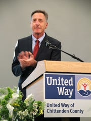 Gov. Peter Shumlin claps after recognizing the United Way of Chittenden County at its Annual Celebration and Awards Tuesday evening at Saint Michael's College.