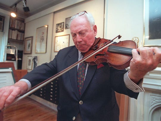 In this photo taken on Tuesday, Jan. 28, 1997, Issac Stern plays his violin at his studio in New York before attending a dedication ceremony at Carnegie Hall. The concert hall Stern saved from the wrecking ball was dedicated to him with the honorary name The Isaac Stern Auditorium.