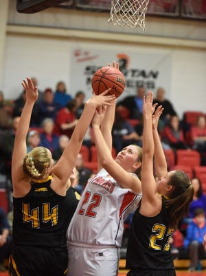 Norfork's Kynzie Rangel goes up for a shot while defended by Salem's Madison Sellars (44) and Kaylea Walling (23) on Thursday night at Norfork.