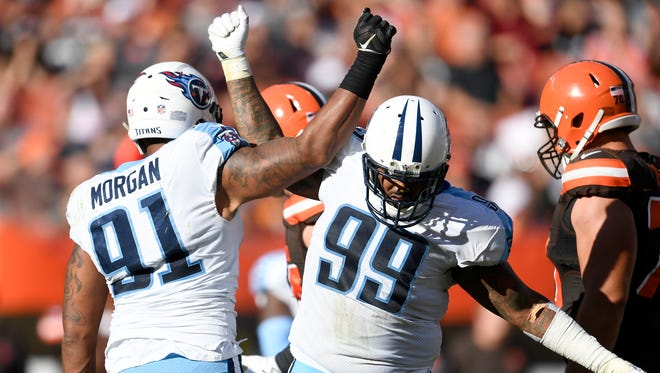 Titans defensive tackle Jurrell Casey (99) celebrates the sack by linebacker Derrick Morgan (91) during the fourth quarter at FirstEnergy Stadium Sunday, Oct. 22, 2017 in Cleveland, Ohio.