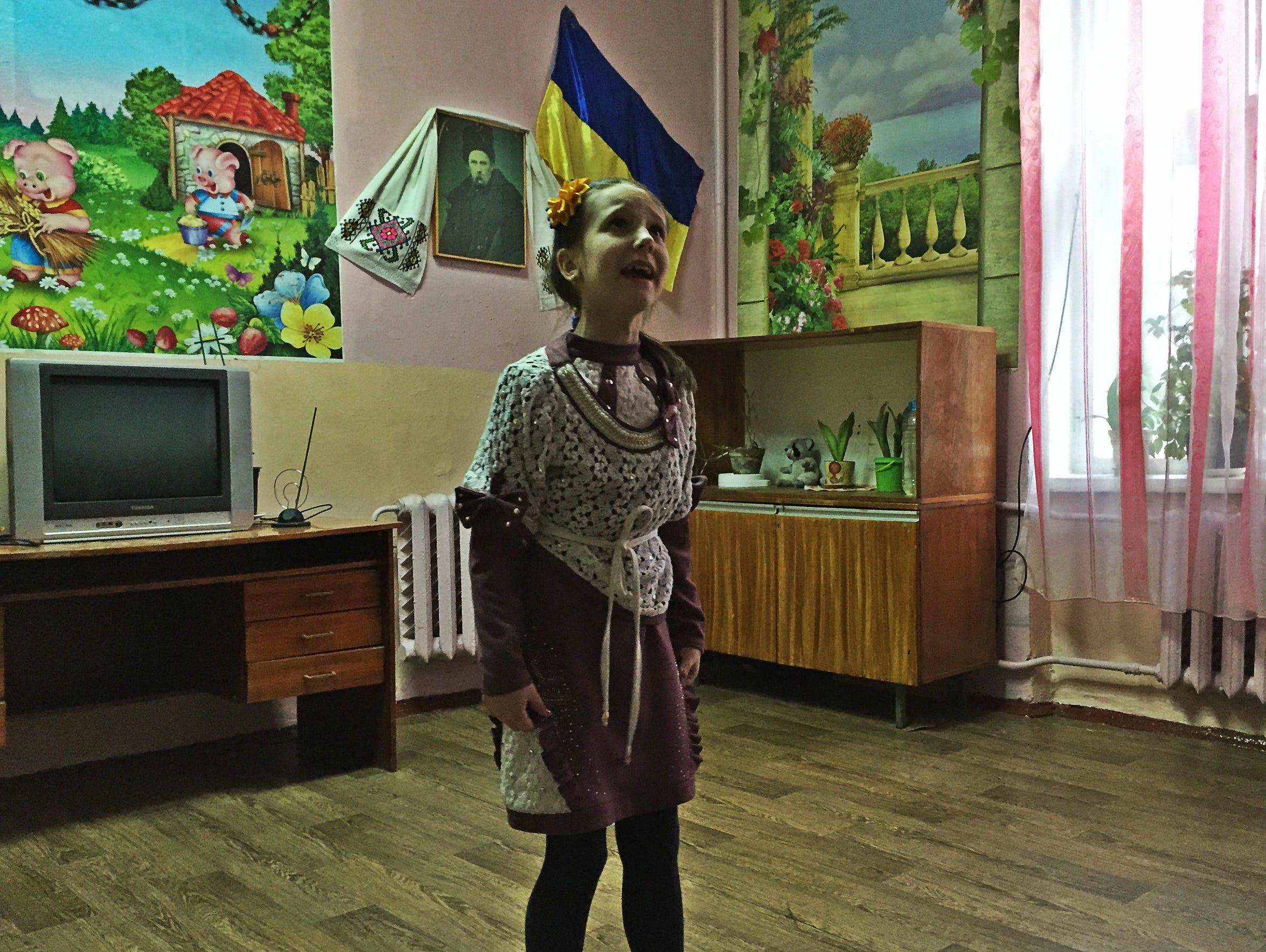 Daryna Bizilya, 10, sings at the institute in Ukraine.