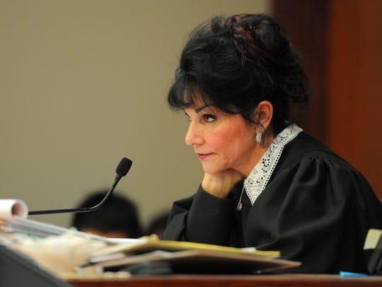 Judge Rosemarie Aquilina looks at the defendant Larry