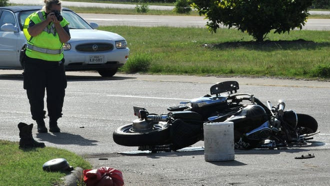 Wichita Falls police investigate the scene of a motorcycle accident that occurred shortly after 8 a.m., Thursday, sending one person to the hospital for a severe leg injury.