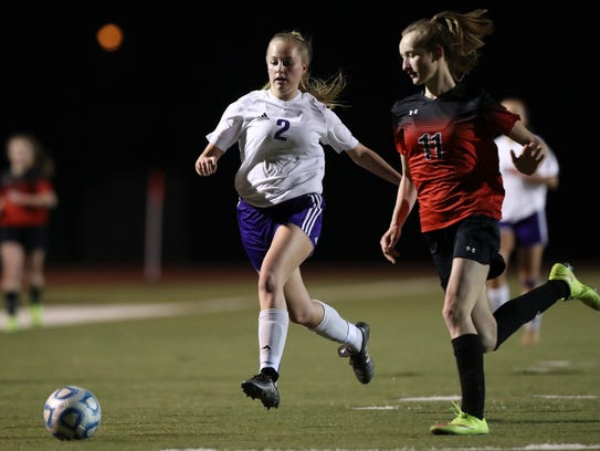 Shasta's Madalyn Peterson moves the ball past Foothill's