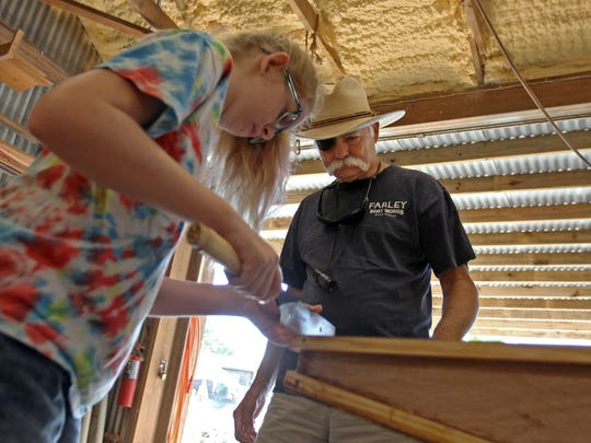 Port Aransas Museum Director Rick Pratt stopped by for a visit during a recent boat-building summer camp at Farley Boat Works.