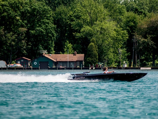 A boat is seen traveling down the St. Clair River Tuesday,