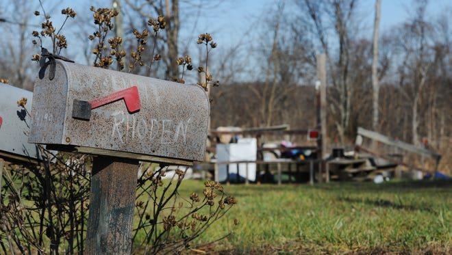 A mailbox, a porch where a trailer stood and miscellaneous items are all that remain Wednesday at one of the locations of the Rhoden family murders on Union Road in April. The case from eight months ago remains unsolved.