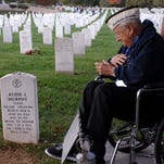 World War II veteran Chick Gallella. during a 2014 Hudson Valley Honor Flight trip to Washington, at  gravesite of World War II's most decorated soldier, Audie Murphy, at Arlington National Cemetery.