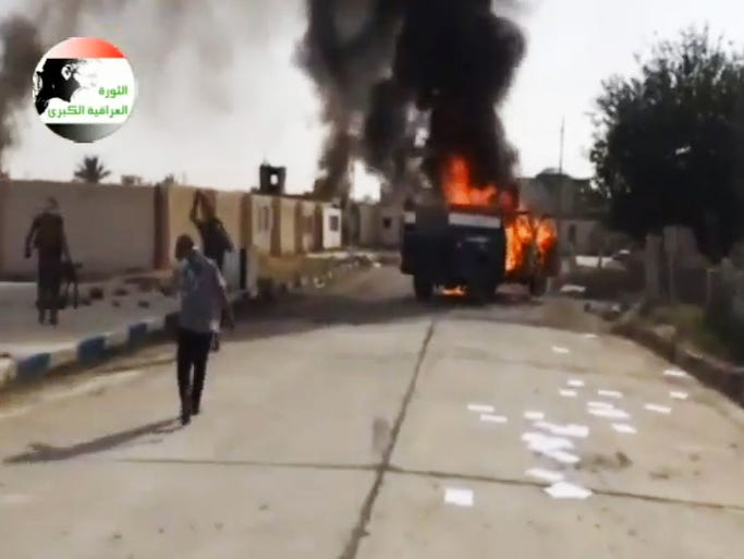 An image from video posted by Iraqi0Revolution, a group supporting the Islamic State of Iraq and the Levant, shows militants on the Al-Sharqat military base north of Tikrit.