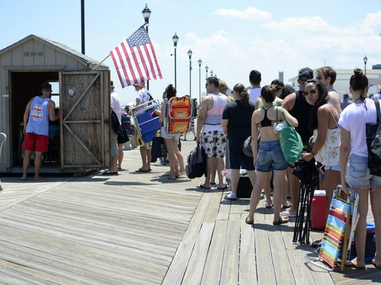Beach patrons wait in line for admission to the beach in Asbury Park on July 2, 2017.