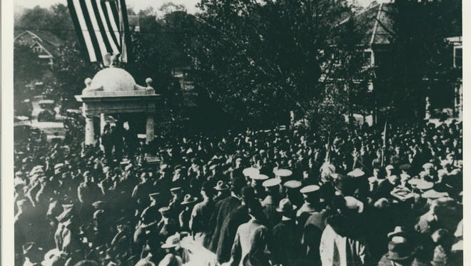The 1919 dedication of original WWI monument in White Plains, with eagle perched on top of the structure, just below the flag.