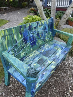 """""""Monet's Japanese Footbridge'' by Nicole Herbst is one of 25 artist-enhanced benches from the Sturgeon Bay Visitor Center's""""Benches By the Bay"""" community art project going in 2017. Artists are being sought for the 2018 benches project."""