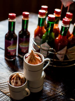 The Raspberry Azalea, a raspberry chipotle Tabasco sauce ice cream drizzled with the sauce, is pictured at the new McIlhenny Company restaurant 1868 on Avery Island, Tuesday, Aug. 4, 2015.
