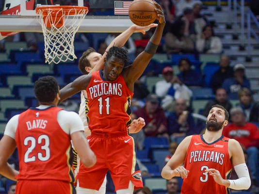 New Orleans Pelicans guard Jrue Holiday (11) jumps for the ball during the first half of the team's NBA basketball game against the Indiana Pacers in New Orleans on Wednesday, March 21, 2018. (AP Photo/Veronica Dominach)