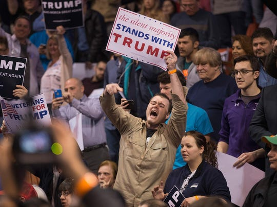 A Donald Trump supporter heckles protesters before