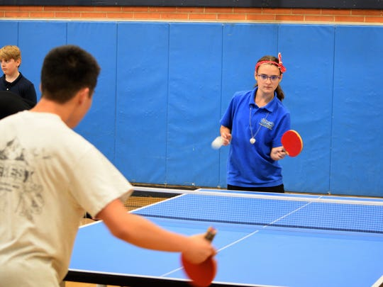 Maisy Faccone, a sixth grader, plays table tennis against Holmdel High School volunteer Ryan Hong at Freehold Borough Schools. Faccone is part of the after-school 21st Century program.