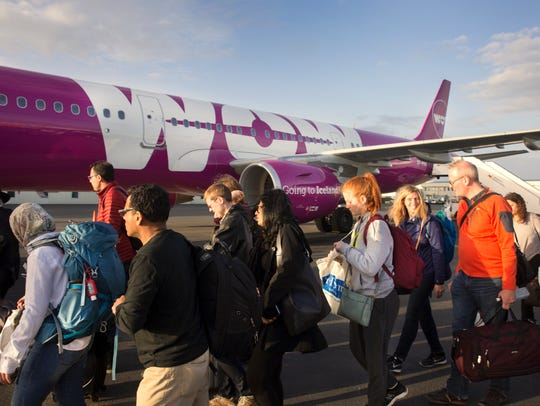 Travelers board WOW Airlines out of Keflavik International Airport in Iceland for non-stop service to Cincinnati.