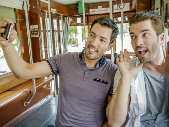 Drew and Jonathan Scott take a selfie down the St.