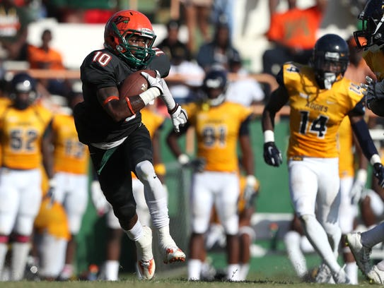 FAMU's Orlando Mckinley returns a kickoff against N.C.