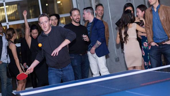 Facebook CEO Mark Zuckerberg playing ping pong at SPiN.
