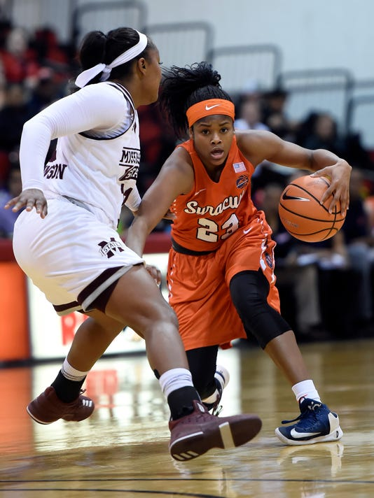 Syracuse guard Isis Young (23) drives the ball against Mississippi State guard Roshunda Johnson (11) during the first half of an NCAA college basketball game Thursday, Dec. 21, 2017, in Las Vegas. (AP Photo/David Becker)