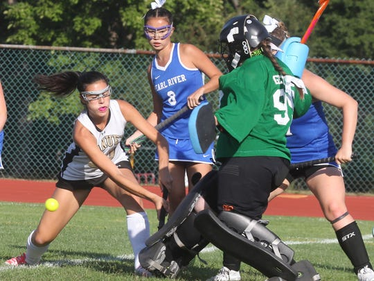 Nanuet's Taylor Rosenfeld, left, is stopped by Pearl River goalie Kerry Gettler during their game at Nanuet Sept. 16, 2016. The game ended in a 0-0 tie.