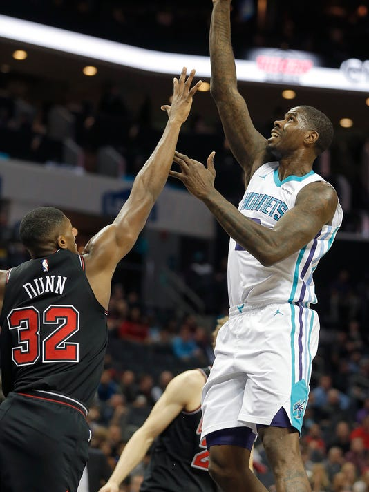 Charlotte Hornets' Marvin Williams (2) gets off a floater off over Chicago Bulls' Kris Dunn (32) during the first half of an NBA basketball game in Charlotte, N.C., Tuesday, Feb. 27, 2018. (AP Photo/Bob Leverone)