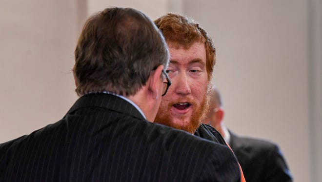 Joseph Daniels talks with attorney Jake Lockert before leaving the courthouse after the preliminary court hearing at the Dickson County General Sessions Court in Charlotte, Tenn., Monday, June 4, 2018.