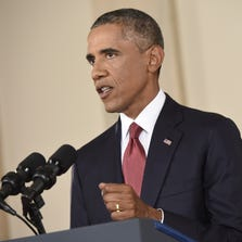 """US President Barack delivers a prime time address from the Cross Hall of the White House on September 10, 2014 in Washington, DC.  Vowing to target the Islamic State with air strikes """"wherever they exist"""", Obama pledged to lead a broad coalition to fight IS and work with """"partner forces"""" on the ground in Syria and Iraq."""