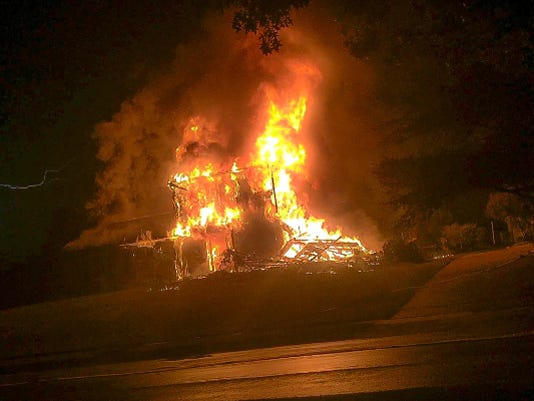 Lightning early Monday morning sparked a Fairview township house fire that caused $250,000 in damage and killed the family dog, according to authorities.