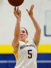 Mukwonago junior Grace Beyer (5) shoots from the line