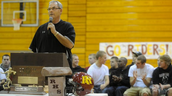 Mark Meile speaks during the celebration party at  Roosevelt following the Rough Riders' 2011 state football title.