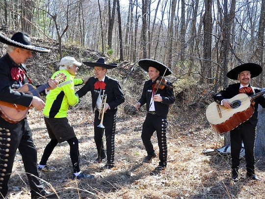 Race organizer and co-founder Tony Godino thanks members of mariachi band, who entertained runners. Photo from Apr 21, 2018