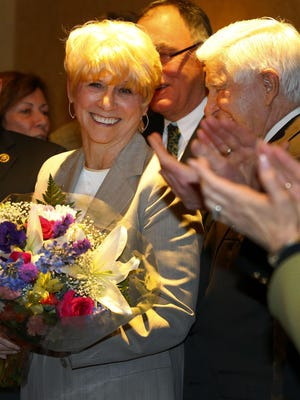 "Ocean County Freeholder-designate Virginia ""Ginny"" Haines of Toms River is given a bouquet of flowers upon her appointment to the county's governing body on Tuesday night at the Toms River Hotel."