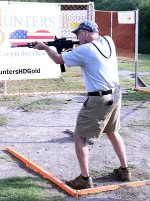 Local marksman Jerry Richards makes his run through one of the stages set up, Thursday, Sept. 17, for the United States Practical Shooting Association Walther Arms Area 4 Championship at Old Fort Gun Club in Van Buren. The 4 - day event features more than 300 professional and amateur shooters as well as the U.S. Army Marksmanship Unit, scheduled for the Friday, Sept. 18, round. The event is free and open to the public with eye and hearing protection recommended.